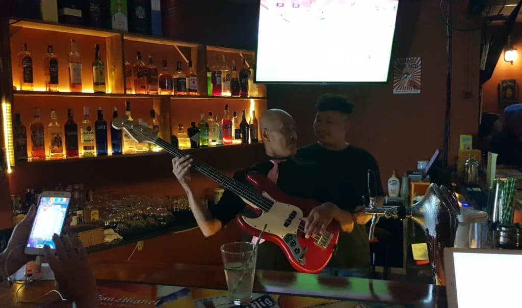Bass player behind the bar at the Rabbit Hole Live Music Venue Phu Quoc